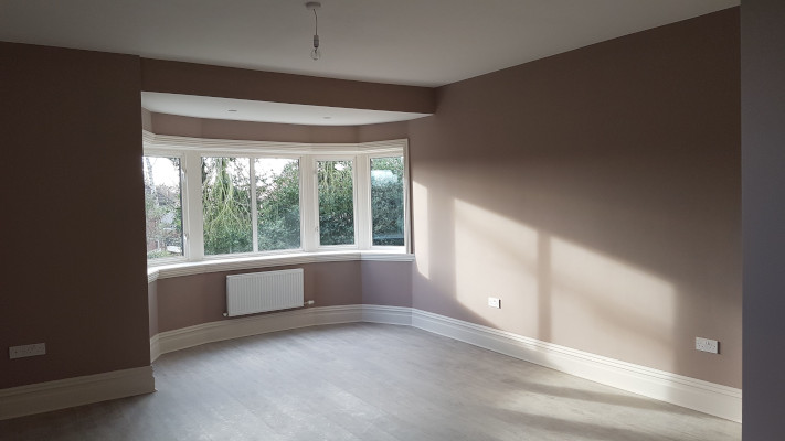 Period Skirting Board in large living room with bay window